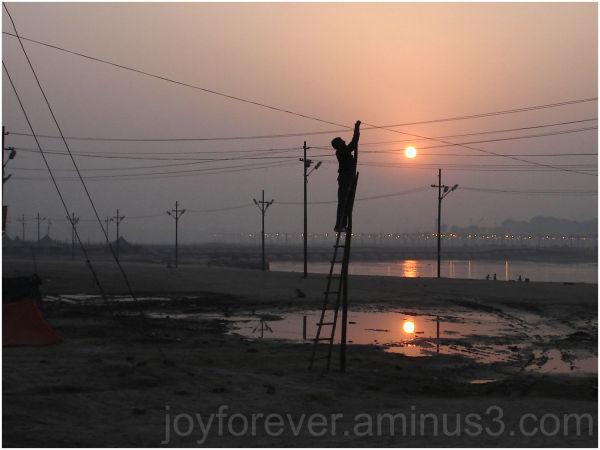 sun silhouette sunset kumbha mela Allahabad India