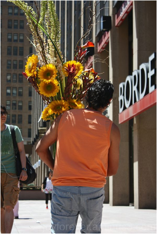 flower man new york city burden load carry