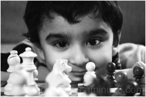 child kid chess chessmen portrait black-and-white