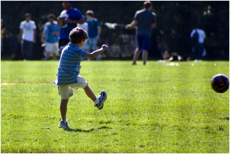 child kick football soccer central-park new-york