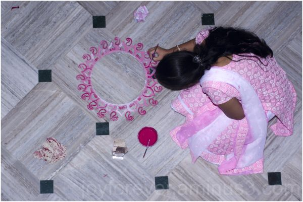 alpana rangoli pink design girl floor Indian