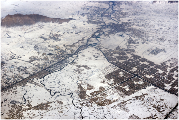 Kabul city Afghanistan snow airplane aerial view
