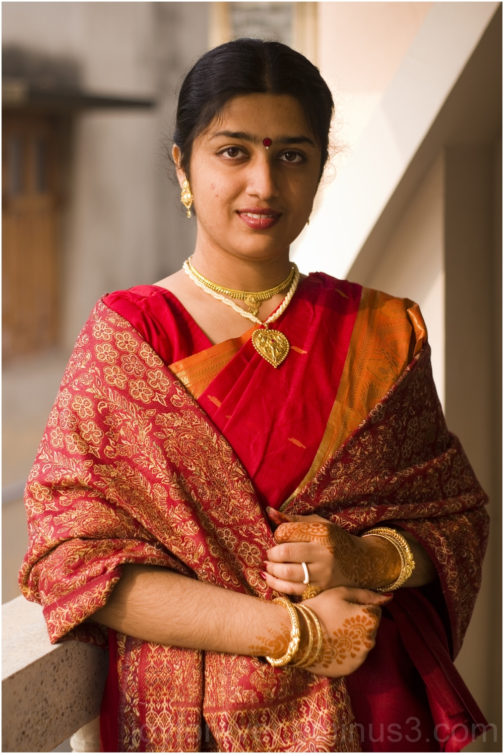 Jolly girl portrait red sari wedding woman balcony