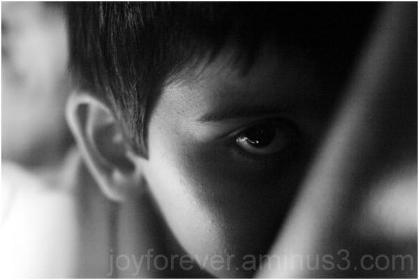 child boy eye close-up dark grain portrait b&w
