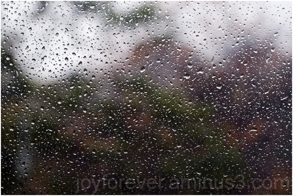 drizzle rain water drops window pane glass storm
