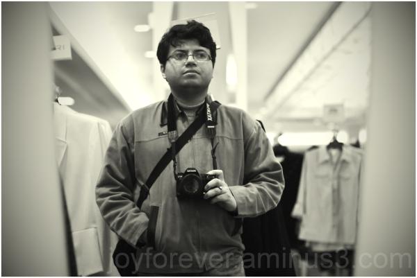 self portrait man camera reflection Macy's NYC