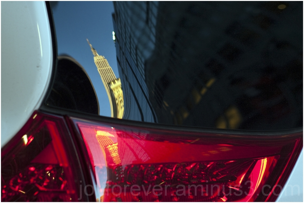 Empire-State-Building car light reflection NYC