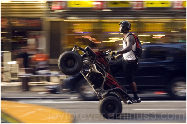 speed street panning NYC man vehicle