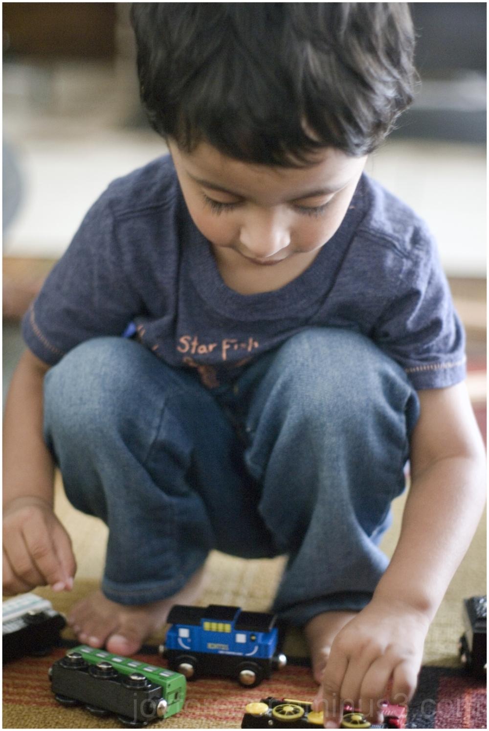 Arjo child boy play toy train blue