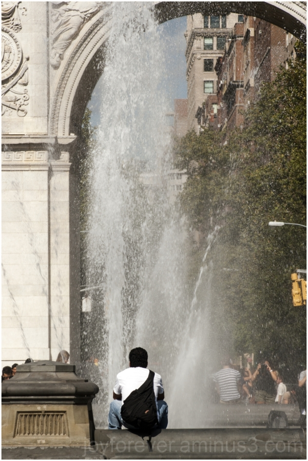 man lonely alone fountain Washington-Square NYC