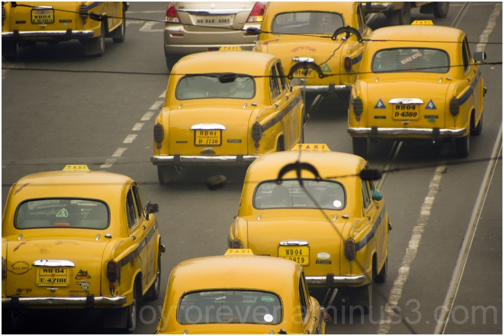yellow taxi cab Kolkata India Ambassador car