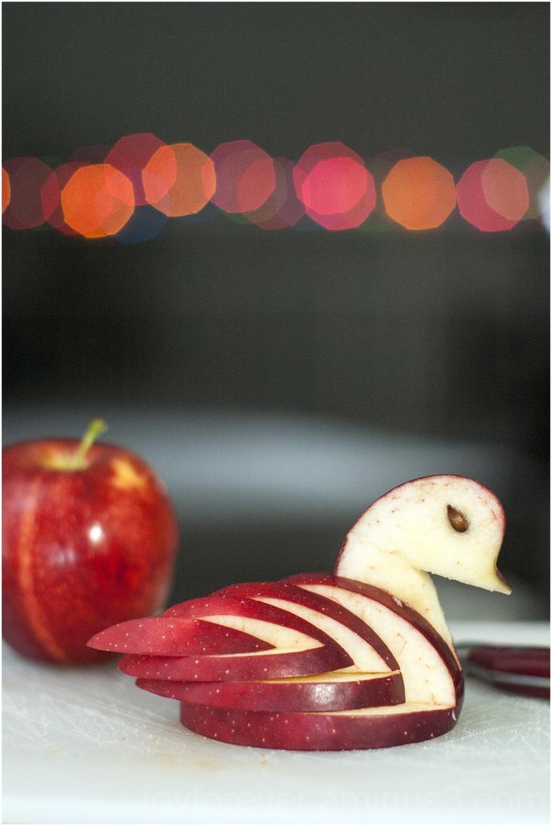 apple fruit carving art duck swan light bokeh