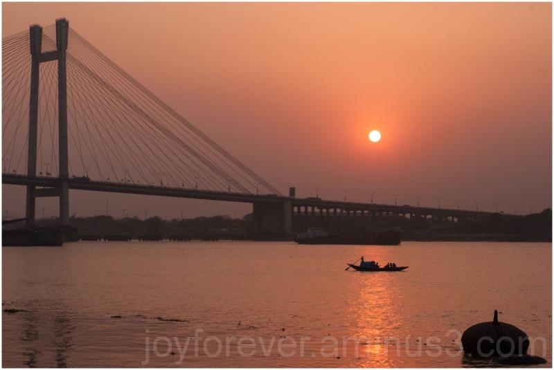 Kolkata India Ganga river bridge Hooghly sunset