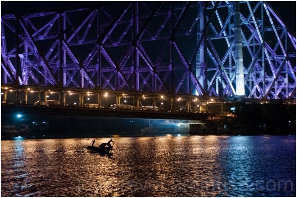 river Ganga bridge boat Howrah night Kolkata India