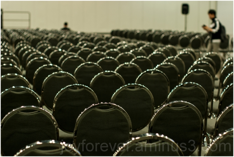 chairs audience auditorium conference empty bokeh