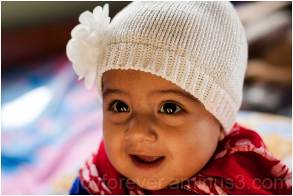 girl child baby infant Tuli cap head portrait