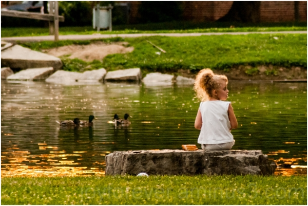 girl child park pond duck bread feeding Columbus