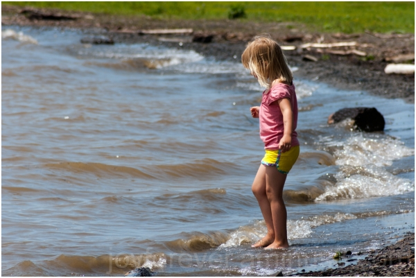 girl child toddler wading water Cayuga Lake NY