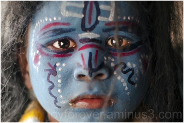 boy facepaint portrait shiva Bengal India blue