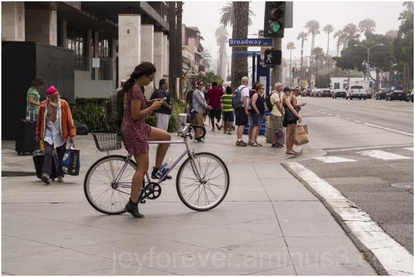 bike girl woman LosAngeles cellphone street