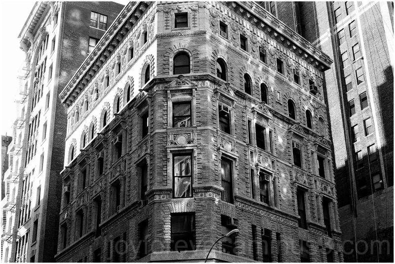 Manhattan building film shadow windows B&W NYC