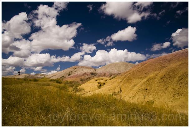 Badlands prairie yellow mound cloud SouthDakota