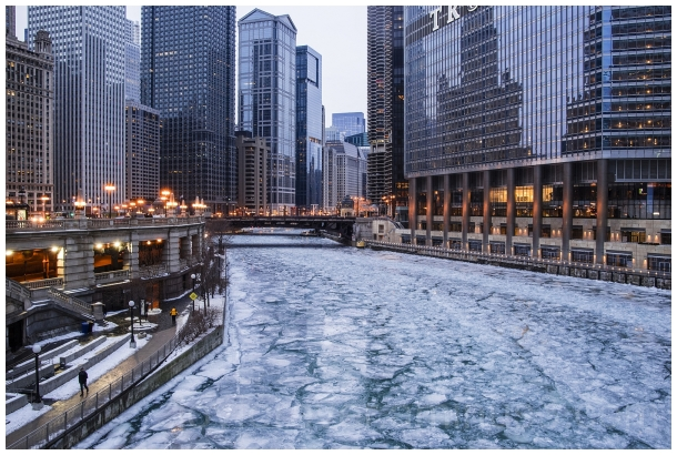 Frozen Chicago river ice winter skyscrapers IL