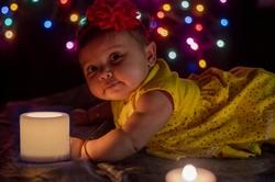 baby child girl Diwali Indian festival lights