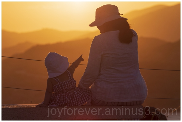 woman child toddler infant sunset Greece Sounion