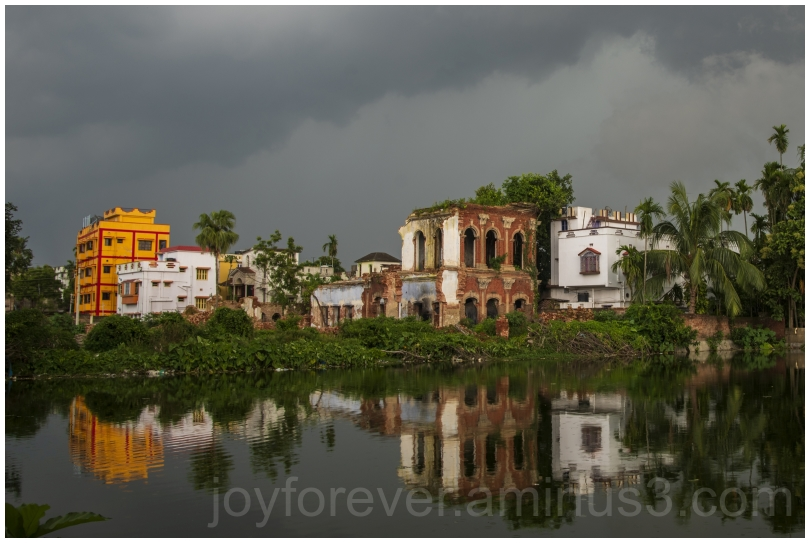 rain clouds Hooghly Bengal India Pond reflection