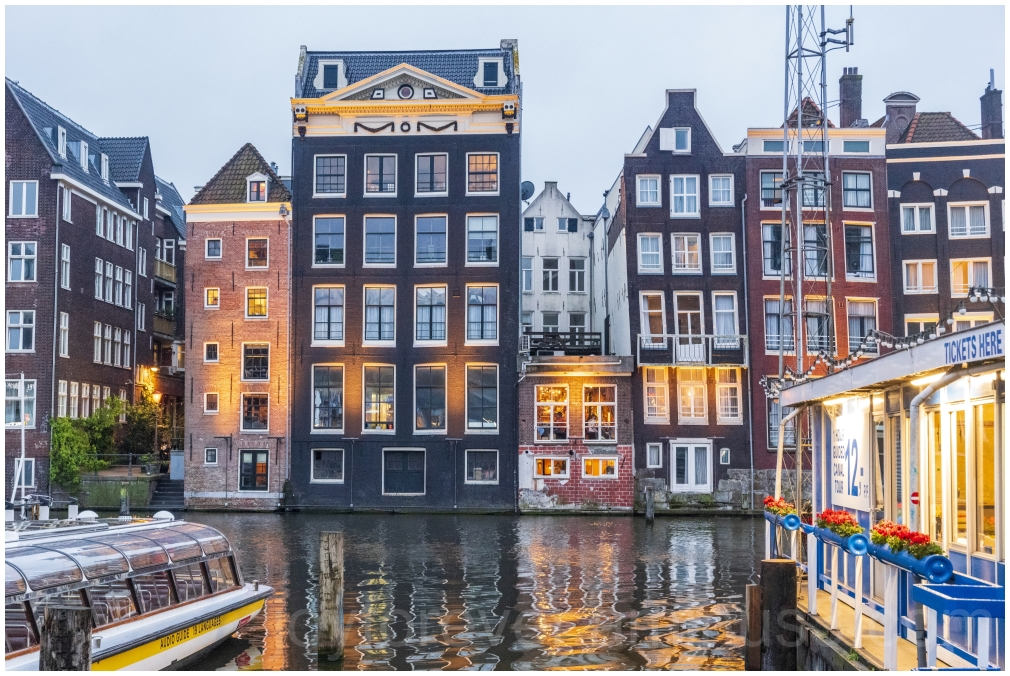 amsterdam netherlands canal water reflection house