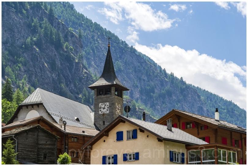 mountain switzerland clock tower village zermatt