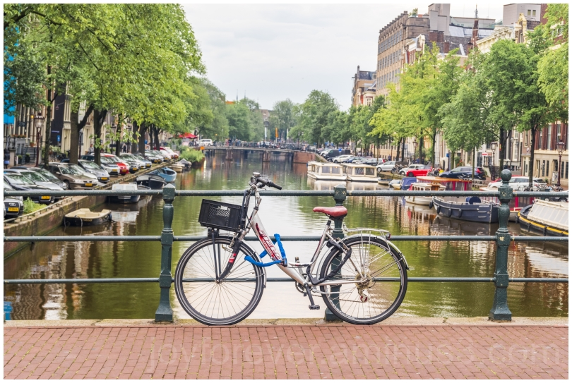 amsterdam netherlands canal water bridge bicycle