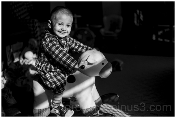 child toddler rocking cow riding blackandwhite B&W