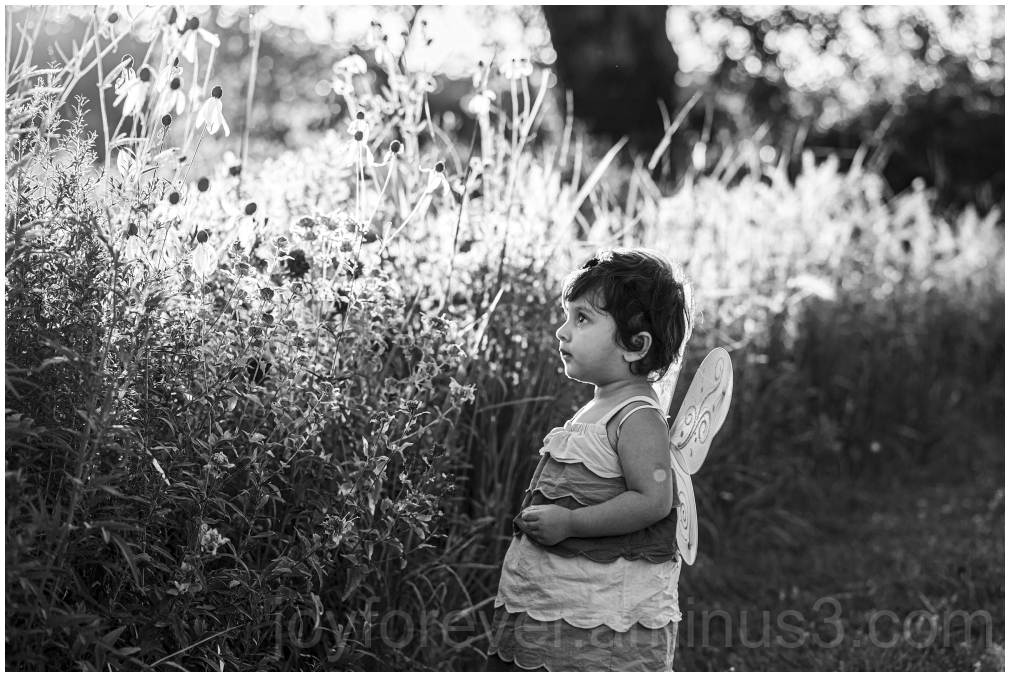 toddler girl child flower grass wings butterfly