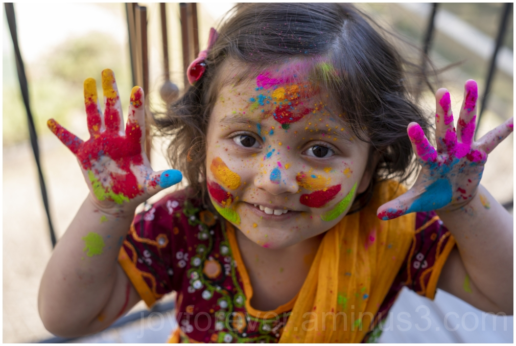 toddler child girl Holi Indian festival colors