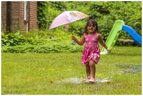 girl toddler rain umbrella dance child