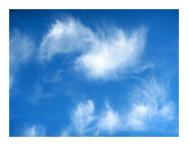 .. blue ski .. white clouds ..