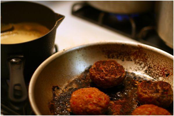 Merguez patties on a frying pan