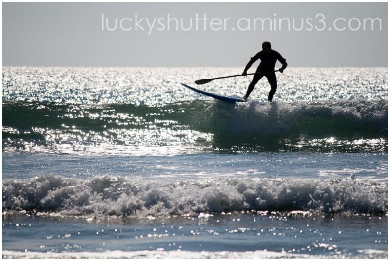 Surfer with Oar
