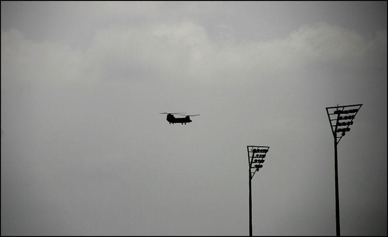 chinook over a stadium.