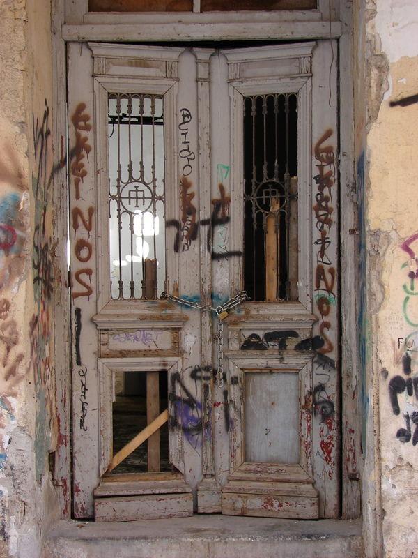 door of an abandoned building