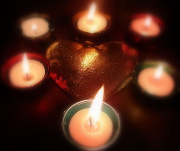 candles around a heart