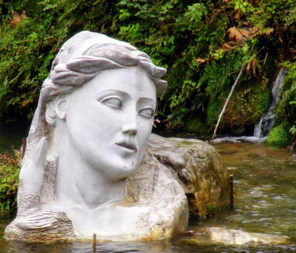 The nymph Hercina's bust in the river