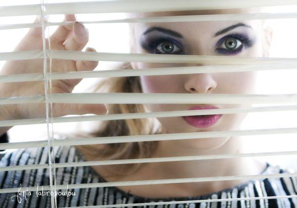 behind blindes