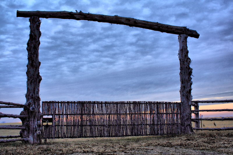 log gate at sunset