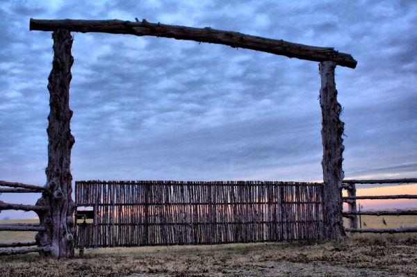 log gate at sunset