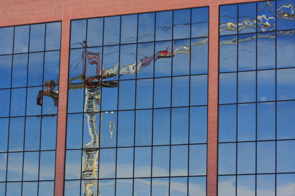 reflection of tower crane in downtown fort worth