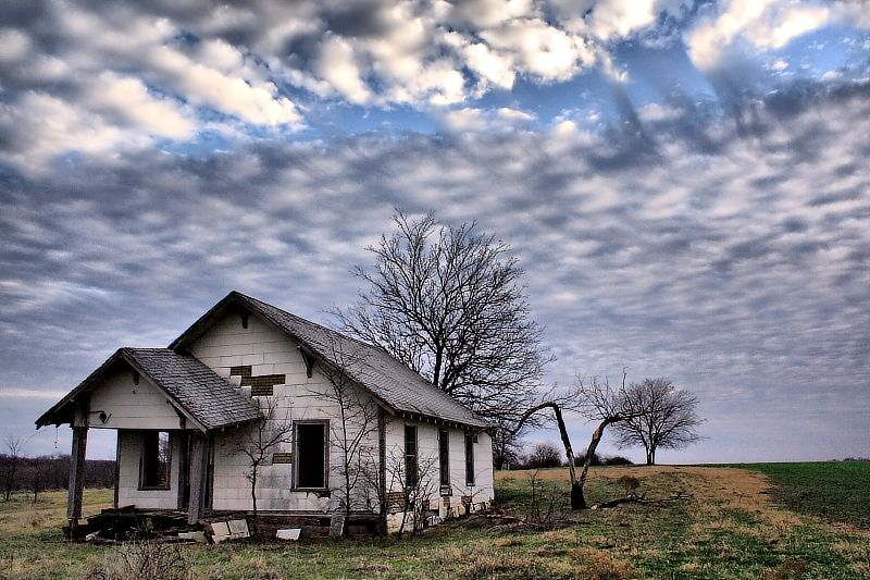 clouds over farmhouse and pasture