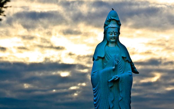 Buddhist temple statue at sunset